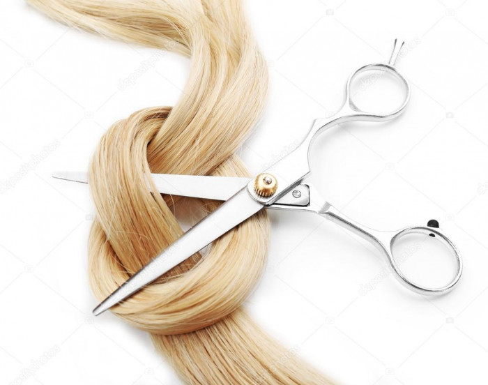 depositphotos_101637078 stock photo hairdressers scissors with strand of